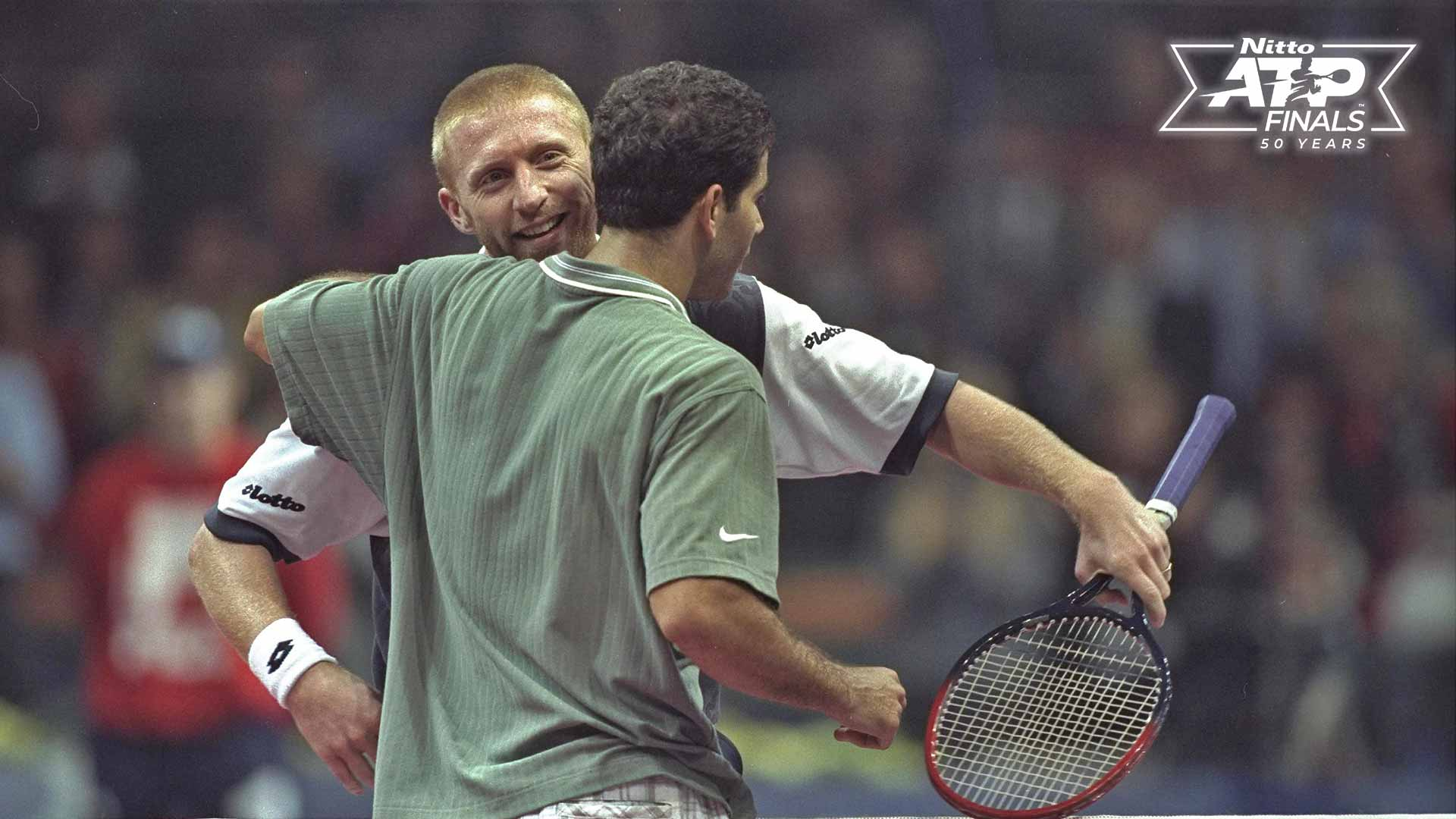 Pete Sampras and Boris Becker embrace after their epic five-set final in 1996 in Hanover.